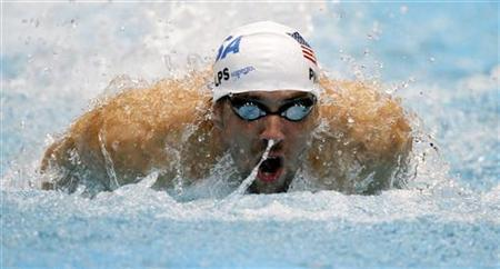 Michael Phelps of the U.S. starts in the men's 100m butterfly qualifying event at the Short Course Swimming World Cup in Berlin October 23, 2011. REUTERS/Tobias Schwarz/Files