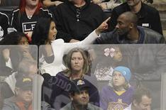 Los Angeles Lakers star Kobe Bryant sits with his daughter Gianna Maria-Onore, ex-wife Vanessa and other daughter Natalia Diamante as they watch the Los Angeles Kings play the Vancouver Canucks during Game 3 of the NHL Western Conference Hockey playoff quarter-finals in Los Angeles, California April 15, 2012. REUTERS/Danny Moloshok