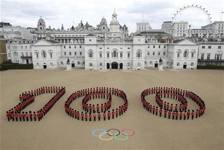 260 Guardsmen from the Grenadier, Coldstream, Scots and Welsh Guards pose for a photograph as they form the number 100, to mark 100 days to go to the London 2012 Olympic Games, on Horse Guards Parade in central London April 16, 2012.  The photograph was taken to mark the 100 days milestone which is on April 18, 2012. Photograph taken on April 16, 2012. REUTERS/LOCOG/Handout