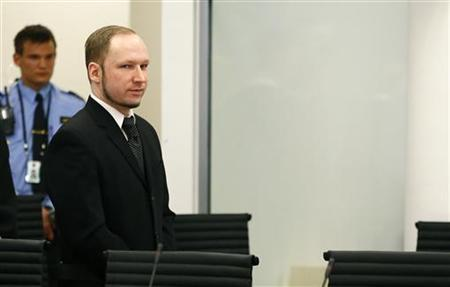 Defendant Anders Behring Breivik arrives to the start of the third day of proceedings in the courthouse in Oslo April 18, 2012. REUTERS/Fabrizio Bensch