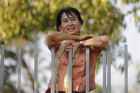 Myanmar's pro-democracy leader Aung San Suu Kyi smiles at supporters as she celebrates Thingyan, Myanmar's new year water festival, in front of her home in Yangon April 16, 2012. REUTERS/Soe Zeya Tun