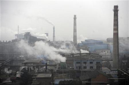 Smoke billows from a coking factory in Hefei, Anhui province March 2, 2012. REUTERS/Stringer/Files