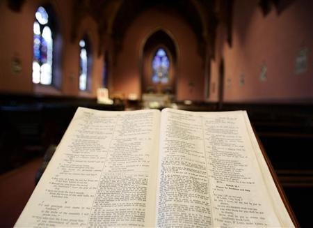 A bible sits open in the Chapel of the Blessed Sacrament where people came to pray for Pope John Paul II at the Cathedral of the Holy Cross in Boston, Massachusetts April 1, 2005. REUTERS/Brian Snyder