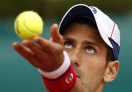 Novak Djokovic of Serbia serves during his match against Andreas Seppi of Italy during the Monte Carlo Masters in Monaco April 18, 2012. REUTERS/Eric Gaillard