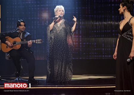 Iranian music star Googoosh (C) performs on stage with guitarist Babak Saeedi (L) watched by a contestant during the season finale of ''Googoosh Music Academy,'' a music competition show on Persian-language entertainment channel Manoto 1, in London in this handout taken November 2011. Launched in 2010, family-owned satellite channel Manoto 1's programming has struck a chord inside Iran and gained what is likely to be millions of fans since launching in 2010, though it is periodically jammed by Iran's Islamic government. The channel was launched by Kayvan and Marjan Abbassi, an Iranian couple, and focuses on entertainment and youth culture. To match Feature BRITAIN-IRAN/TV REUTERS/Manoto/Handout