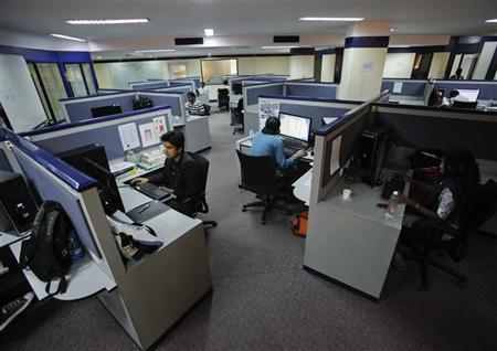 Workstations are seen in a office in Bangalore, February 27, 2012. REUTERS/Vivek Prakash/Files