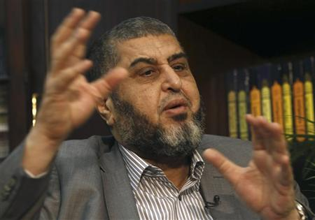 Presidential candidate from the Muslim Brotherhood and the Freedom and Justice Party (FJP), Khairat al-Shater gestures during an interview with Reuters at his office in Cairo April 8, 2012. REUTERS/Amr Abdallah Dalsh