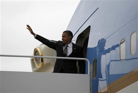 U.S. President Barack Obama waves as he steps aboard Air Force One at Andrews Air Force Base near Washington April 18, 2012. REUTERS/Jason Reed