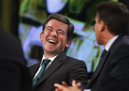 Britain's Minister for Sport, Hugh Robertson, laughs as Sebastian Coe (R), chairman of the London organising committee of the Olympic Games (LOCOG), answers a question during a Reuters Newsmaker event in the Canary Wharf district of London July 21, 2011. REUTERS/Andrew Winning/Files
