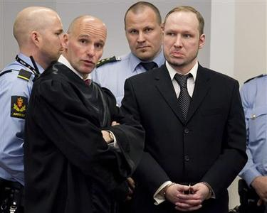 Defendant Anders Behring Breivik (R) is seen with his lawyer Geir Lippestad during the third day of proceedings in the courthouse in Oslo April 18, 2012. REUTERS/Heiko Junge/Scanpix Norway/Pool