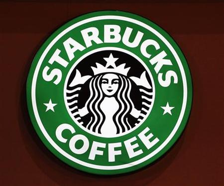 The old Starbucks logo is seen on a coffee store in Paris March 8, 2011. REUTERS/Regis Duvignau