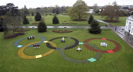 Olympic rings made up of 25,000 flowers are seen at Kew Gardens in London April 18, 2012. REUTERS/ Lewis Whyld/Pool