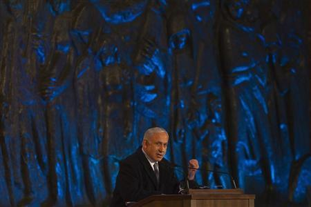 Israel's Prime Minister Benjamin Netanyahu speaks during the opening ceremony of the annual Holocaust Memorial Day at the Yad Vashem Holocaust Memorial in Jerusalem April 18, 2012. Israel marks the annual memorial day commemorating the six million Jews killed by Nazis in the Holocaust during World War Two. REUTERS/Ronen Zvulun