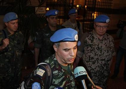 Colonel Ahmed Hommich (C), a member of a U.N. monitors team, speaks to the media at a hotel in Damascus April 16,2012. A United Nations advance observers' team arrived in the Syrian capital Damascus late Sunday to monitor the fragile cease-fire brokered by international envoy Kofi Annan, causing discussion from all circles in Syria. REUTERS/Khaled al- Hariri