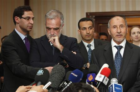 Libyan National Transitional Council (NTC) chairman Mustafa Abdel Jalil (R) speaks while International Criminal Court (ICC) war crimes prosecutor Luis Moreno-Ocampo (2nd L) listens on during a news conference in Tripoli April 18, 2012. Moreno-Ocampo arrived in Tripoli on Wednesday as part of an investigation into charges against Muammar Gaddafi's detained son, Saif al-Islam, sought for trial by the ICC. REUTERS/Ismail Zitouny