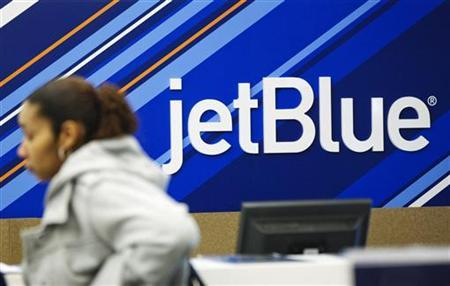 A customer waits to talk with a representative at a JetBlue Airways counter at LaGuardia Airport in New York April 5, 2012. REUTERS/Lucas Jackson