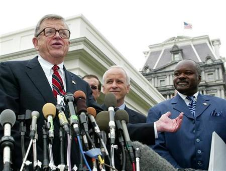 Former Nixon Administration senior staff member and Watergate figure Chuck Colson talks to the press following a roundtable discussion with U.S. President George W. Bush on Prison Fellowship Ministries outside of the White House, June 18, 2003. REUTERS/Larry Downing