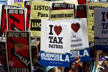 Activists, labor unions and Occupy LA protestors march on Tax Day in Los Angeles, California April 17, 2012. REUTERS/Patrick T. Fallon