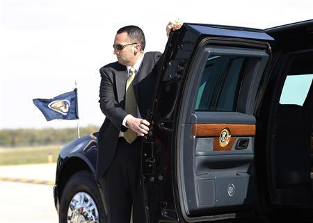 A U.S. Secret Service Agent holds the limousine door of U.S. President Barack Obama upon his arrival in Detroit, Michigan, April 18, 2012. REUTERS/Jason Reed