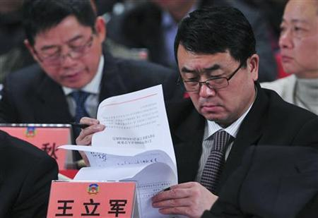 Wang Lijun reads documents as he attends a session of the Chinese People's Political Consultative Conference (CPPCC) of the Chongqing Municipal Committee, in Chongqing municipality, January 7, 2012. REUTERS/Stringer
