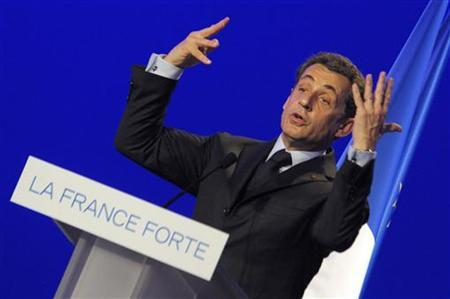 France's President and UMP party candidate for the 2012 French presidential election, Nicolas Sarkozy, delivers a speech at a electoral rally in Arras, Northern France, April 18, 2012. REUTERS/Philippe Wojazer