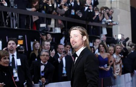 Brad Pitt, best actor nominee for his role in ''Moneyball,'' poses at the 84th Academy Awards in Hollywood, California, February 26, 2012. REUTERS/Mario Anzuoni/Files