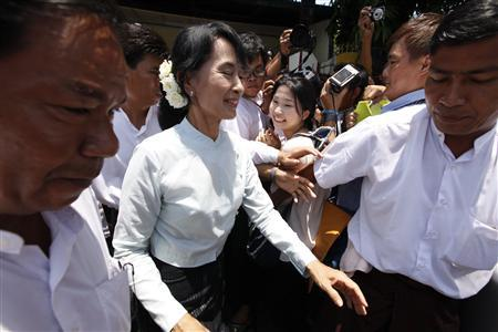 Newly elected lawmaker Aung San Suu Kyi leaves the National League for Democracy party's head office after attending a training course in Yangon April 19, 2012. REUTERS/Soe Zeya Tun