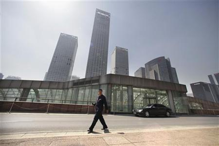 A security guard walks in front of Yintai Centre in Beijing's central business district April 13, 2012. REUTERS/Jason Lee