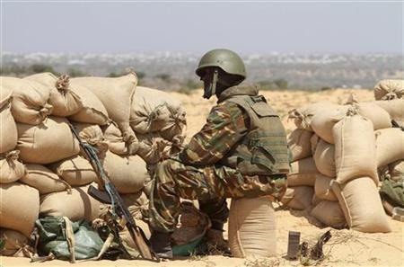 An African Union soldier sits behind sand bags during fighting against al Shabaab militants in the district of Daynile, south of capital Mogadishu March 30, 2012. REUTERS/Feisal Omar