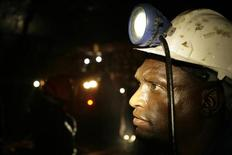A mine worker looks on underground in Modderfontein east mine, outside Johannesburg, February 3, 2009.  REUTERS/Siphiwe Sibeko