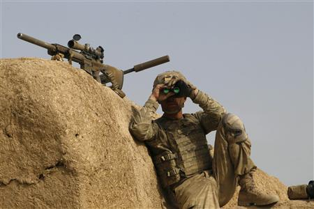A U.S. Army sniper from 4-73 Cavalry Regiment, 82nd Airborne Division uses binoculars during a mission in Zhary district of Kandahar province, southern Afghanistan April 18, 2012. REUTERS/Baz Ratner