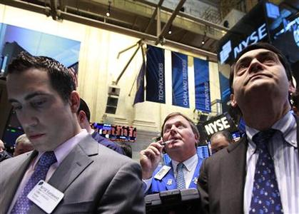 Traders work on the floor of the New York Stock Exchange, April 18, 2012. REUTERS/Brendan McDermid