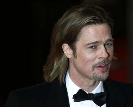 Actor Brad Pitt arrives for the British Academy of Film and Arts (BAFTA) awards ceremony at the Royal Opera House in London February 12, 2012. REUTERS/Luke MacGregor