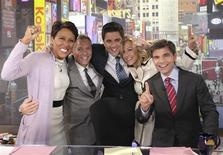 "The ABC's ""Good Morning America"" anchors (L to R) Robin Roberts, Sam Chapman, Josh Elliott, Lara Spencer and George Stephanopoulos, celebrate becoming No. 1 ranking in the week of April 9th in New York in this April 19, 2012 handout photo. REUTERS/Fred Lee/ABC/Handout"