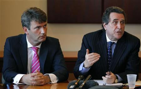 Mark Lewis (L), British lawyer who has led the fight for victims of the News Corporation phone hacking scandal, sits with New York attorney Norman Siegel during a news conference in New York April 19, 2012. REUTERS/Mike Segar