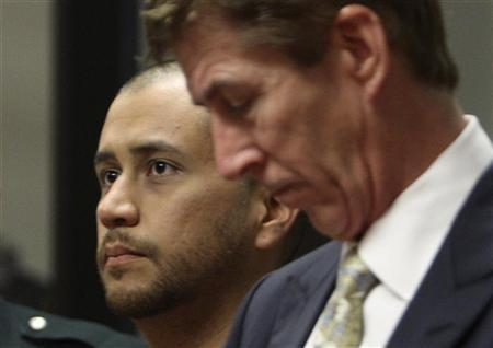 George Zimmerman (L) stands with his attorney Mark O'Mara (R) as he makes his first appearance on second degree murder charges in the shooting death of Trayvon Martin in courtroom J2 at the Seminole County Correctional Facility in Sanford, April 12, 2012. REUTERS/Gary W. Green/Pool