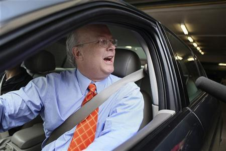 Former Bush White House official Karl Rove drives by reporters after being interviewed by federal prosecutors at his attorney's offices in Washington, May 15, 2009. REUTERS/Robert Giroux