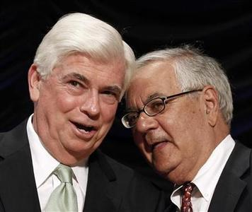 Co-sponsors of the Dodd-Frank Wall Street Reform and Consumer Protection Act, Sen. Christopher Dodd (L) and Rep. Barney Frank, wait for U.S. President Barack Obama to sign it into law at the Ronald Reagan Building in Washington, July 21, 2010. REUTERS/Larry Downing