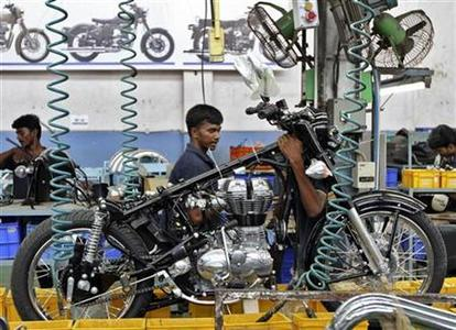 Workers assemble a Royal Enfield motorcycle inside its factory in Chennai April 6, 2012. REUTERS/Babu