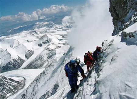 Japanese mountaineer Takako Arayama, 70, leads other climbers on the way to the top of Mount Everest May 17, 2006. REUTERS/Stringer