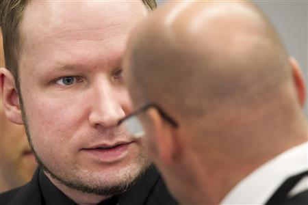 Defendant Anders Behring Breivik (L), who is expected to give his account of events on the July 22, 2011 attacks at Utoeya island, looks at his defence lawyer Geir Lippestad in court on the fifth day of his trial in Oslo, April 20, 2012. REUTERS/Heiko Junge/Scanpix/Pool