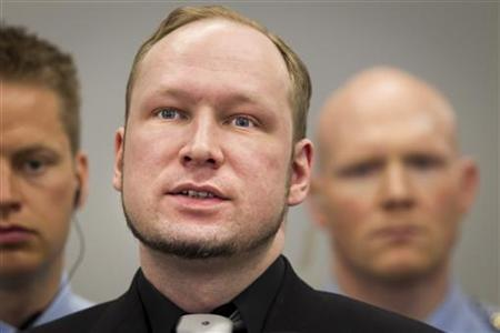 Defendant Anders Behring Breivik, who is expected to give his account of events on the July 22, 2011 attacks at Utoeya island, is pictured in court on the fifth day of his trial in Oslo, April 20, 2012. REUTERS/Heiko Junge/Scanpix/Pool