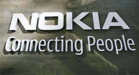 The corporate logo hangs on a wall at Nokia world headquarters in Helsinki July 9, 2008. Picture taken July 9, 2008. REUTERS/Bob Strong