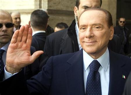 Italy's former prime minister Silvio Berlusconi waves as he arrives at the Lower House of Parliament in Rome November 18, 2011. REUTERS/Remo Casilli