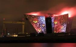 The Titanic centre in Belfast is illuminated by digital projections and pyrotechnics as part of the city's festival of events to commemorate the 100th anniversary of Titanic's fateful maiden voyage April 7, 2012. REUTERS/Cathal McNaughton