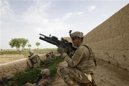 A U.S. Army soldier from 4-73 Cavalry Regiment, 82nd Airborne Division fires his M203 grenade launcher during a firefight with the Taliban during a mission in Zhary district of Kandahar province, southern Afghanistan April 18, 2012. REUTERS/Baz Ratner