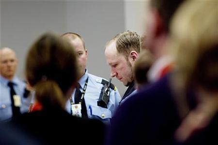 Defendant Anders Behring Breivik is pictured in the courtroom during the fifth day of his trial in Oslo, April 20, 2012. REUTERS/Stian Lysberg Solum/Scanpix/Pool