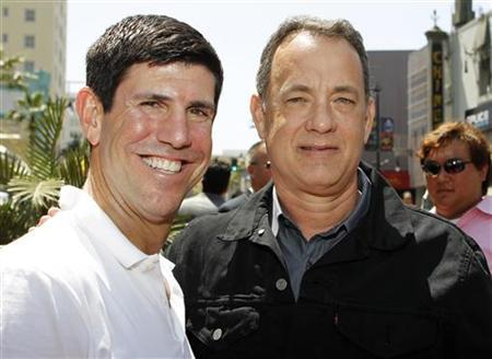 The Walt Disney Studios Chairman Rich Ross (L) and actor Tom Hanks pose at the world premiere of Disney Pixar's ''Toy Story 3'' at the El Capitan Theatre in Hollywood, California June 13, 2010. REUTERS/Danny Moloshok