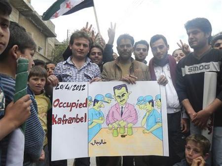 Demonstrators protest against Syria's President Bashar Al-Assad after Friday Prayers in Kafranbel, near Idlib April 20, 2012. REUTERS/Raad Al Fares/Shaam News Network/Handout