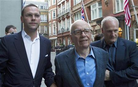 News International Chairman, James Murdoch (L), his father Rupert (C), and a minder are seen leaving the Stafford Hotel in central London in this July 10, 2011 file photograph. REUTERS/Olivia Harris/Files